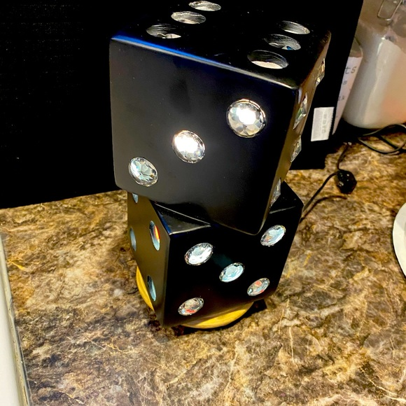 Black dice shape complete with light.